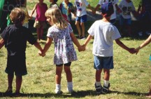 Children Holding Hands on School Playground